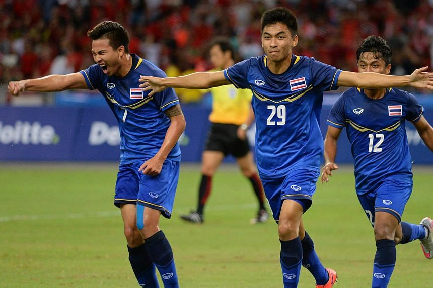 Thailand's Rungrat Phumichantuk (No.29) celebrating after scoring his side's first goal against against Malaysia in their SEA Games football semi-final at the National Stadium in Singapore on June 13, 2015. -- ST PHOTO: CHONG JUN LIANG