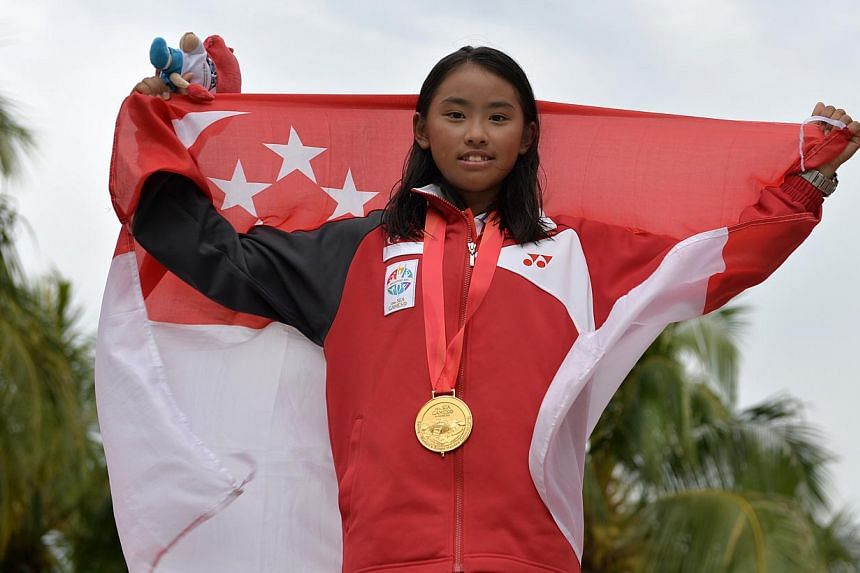 Singapore's Jodie Lai with her gold medal in the female single handed optimist (U16) finals on June 13, 2015. -- ST PHOTO:CAROLINE CHIA