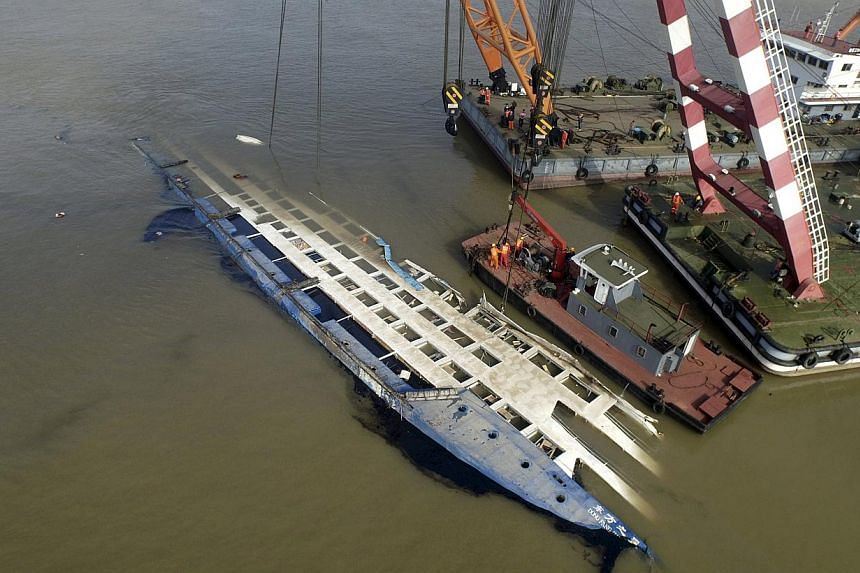 An aerial view of rescuers working on righting the capsized cruise ship Eastern Star, in Jianli, Hubei province, China, June 5, 2015. -- PHOTO: REUTERS