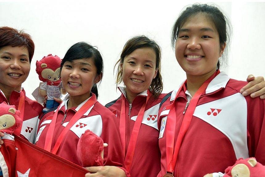 The Women's Team take bronze at the SEA Games squash victory ceremony at the Kallang Squash Centre Court. - ST PHOTO: KUA CHEE SIONG