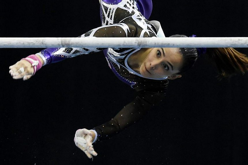 Malaysia's Farah Ann Abdul Hadi competing on the uneven bars during the women's individual all-around gymnastics final at the SEA Games on June 8, 2015. -- PHOTO: AFP