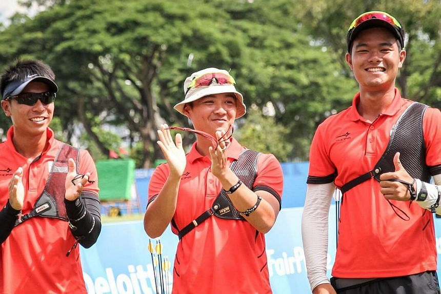 Singapore archers (from left) Tan Si Lie, Keith Teo and Zhang Jingkang won bronze in themen's team recurve event on June 13, 2015. -- PHOTO:DYAN TJHIA/SPORT SINGAPORE