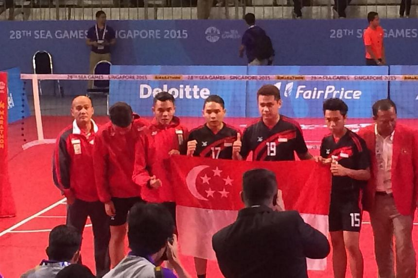 The Singapore men's sepak takraw team clinched their first medal in over two decades with a silver in the final men's regu match on June 13, 2015. -- ST PHOTO: LIM CHING YING