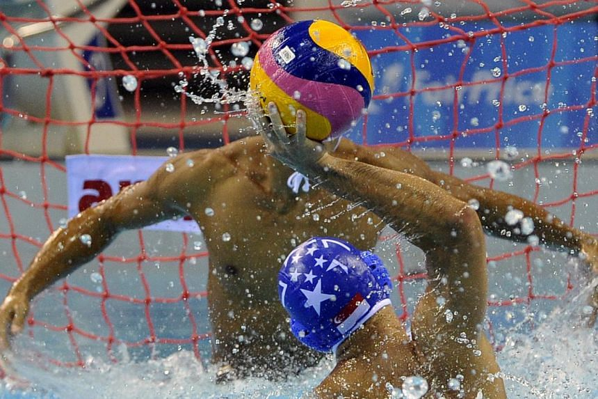 Singapore's Chiam Kunyang (No. 7) attempting to score against his Filipino opponent in their men's water polo match at the OCBC Aquatic Centre on June 14, 2015. -- PHOTO: SINGAPORE SEA GAMES ORGANISING COMMITTEE/ACTION IMAGES VIA REUTERS
