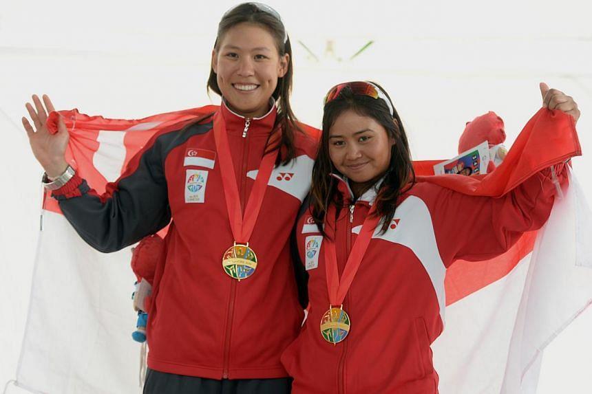 Gold medalists for the skiff49erfx event, Griselda Khng and Sara Li of Singapore.-- ST PHOTO:DESMOND FOO
