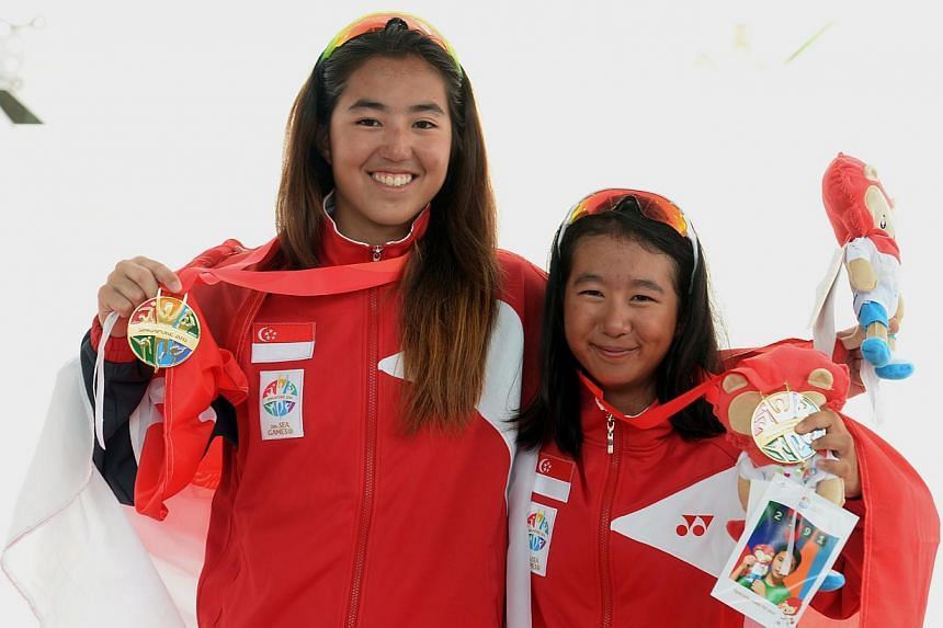 Gold medal winners in the female youth under -19 420 class event, Samantha Annabelle Neubronner and Elisa Yukie Yokoyama from Singapore.-- ST PHOTO:DESMOND FOO