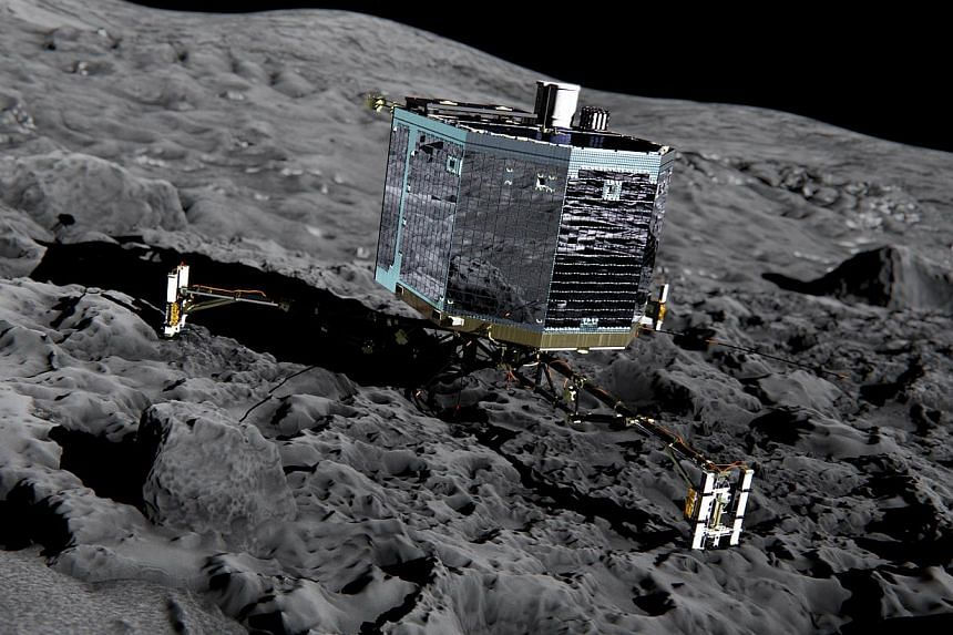 This file picture released by the European Space Agency on Dec 20, 2013 of an artist's impression of Rosetta's lander Philae (front view) on the surface of comet 67P/Churyumov-Gerasimenko.Europe's comet lander Philae has woken up overnight