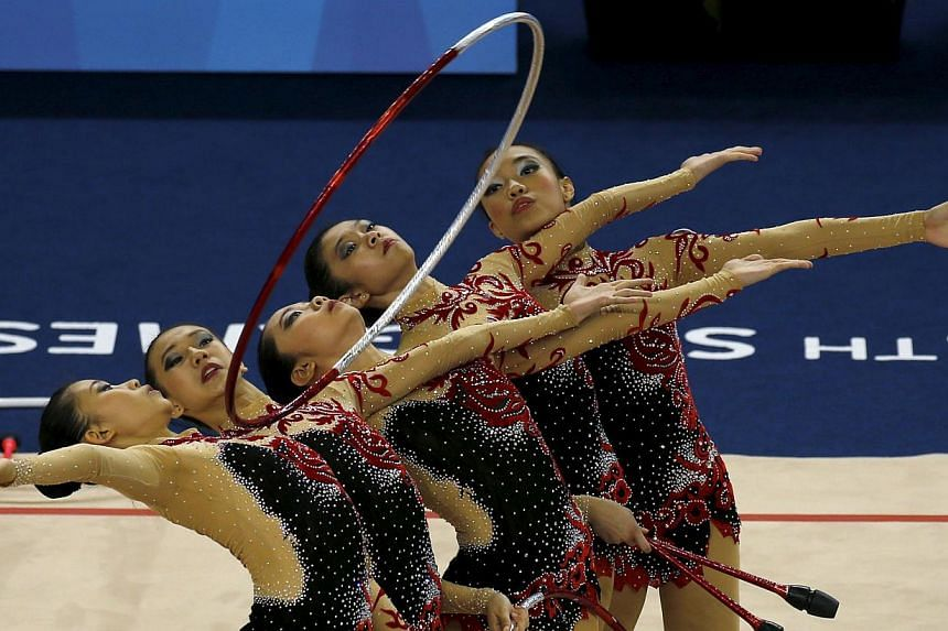 Singapore's rhythmic gymnastic team performing during the group all-around finals at the Bishan Sports Hall on June 14, 2015. -- PHOTO: REUTERS