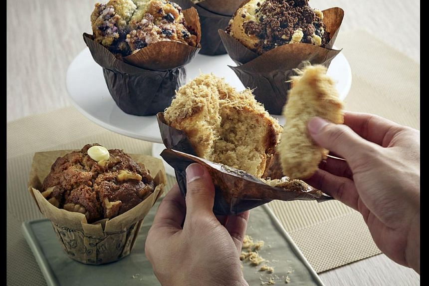 Tasty treats include (from far left) Olive Polenta & Salami, Salted Egg Yolk and Corn & Scallion from Gourmet Carousel; Popped cupcake from Dessert Cup (below); and chicken floss muffin from Starbucks. Fluff Bakery owner Nursyazanna Syaira with her c