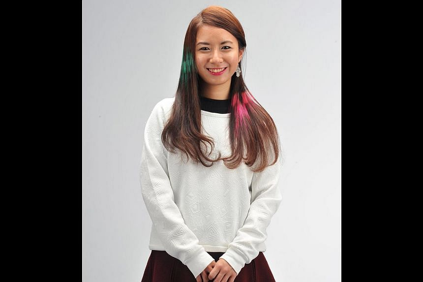 Events manager Amelia Koh's job gives her the flexibility of sporting daring hairstyles so she decided to give the pixellated look a go. -- PHOTO: LIM YAOHUI FOR THE SUNDAY TIMES