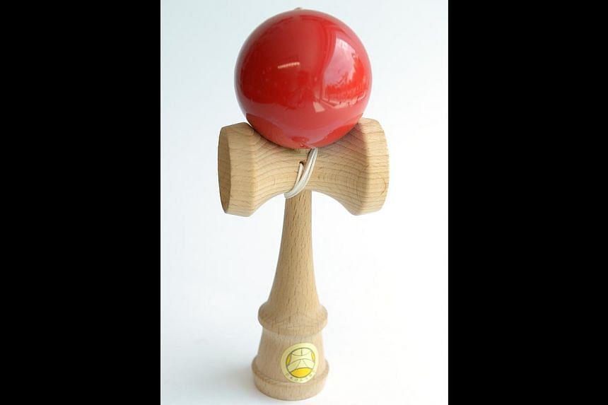 Simple wooden toy, Kendama (above). -- ST PHOTO: DESMOND WEE