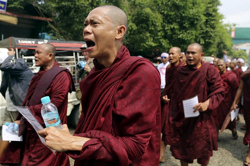 Buddhist monks shout during a march to denounce foreign criticism of the country's treatment of stateless Rohingya Muslims, in Yangon, Myanmar, on May 27, 2015. About 500 Buddhist hardliners, backed by monks, gathered in Sittwe, in troubled Rakhine s