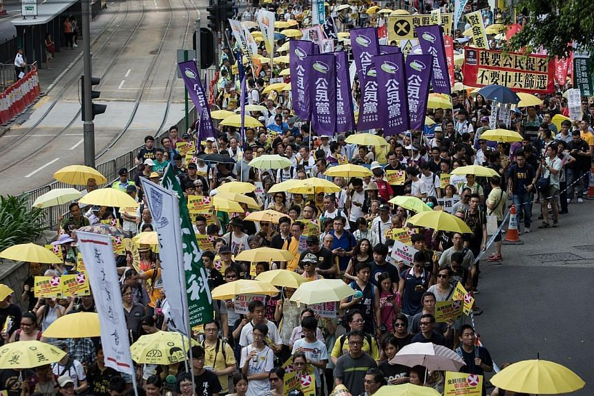 People marching during a pro-democracy rally in Hong Kong on June 14, 2015. The turnout is smaller than expected. -- PHOTO: AFP