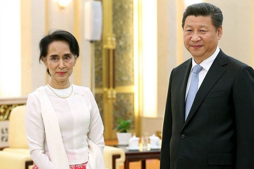 China's President Xi Jinping and Myanmar pro-democracy leader Aung San Suu Kyi pose for pictures during their meeting at the Great Hall of the People in Beijing, China, on June 11, 2015. The Myanmar opposition leader wrapped up her first visit to Chi