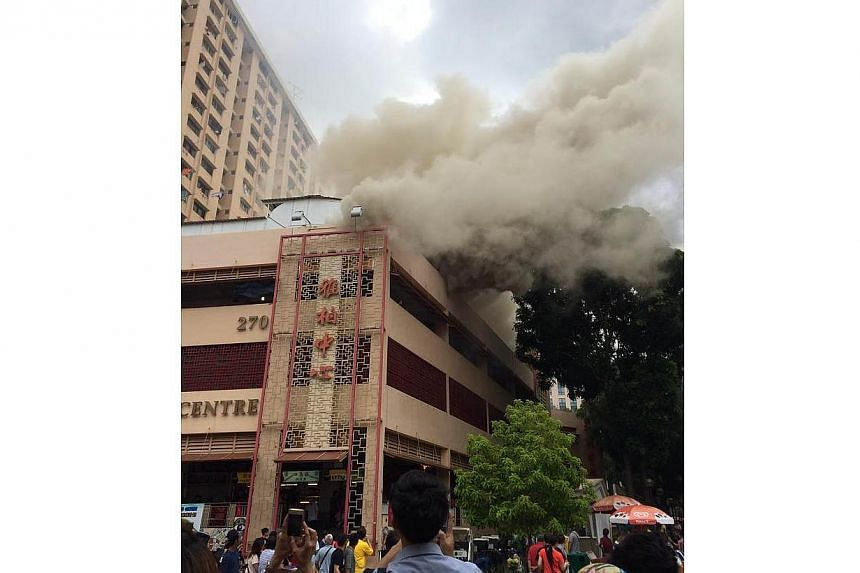 A fire broke out at the Albert Centre Market and Food Centre, but no one was injured in the incident on Sunday afternoon. -- PHOTO: RUBY ELTAGONDE CLET