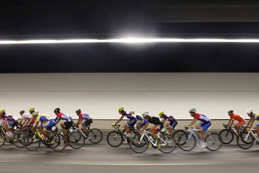 Cyclists along Marina Bay South in the SEA Games men's road race on June 14, 2015. -- PHOTO: SINGAPORE SEA GAMES ORGANISING COMMITTEE/ACTION IMAGES VIA REUTERS