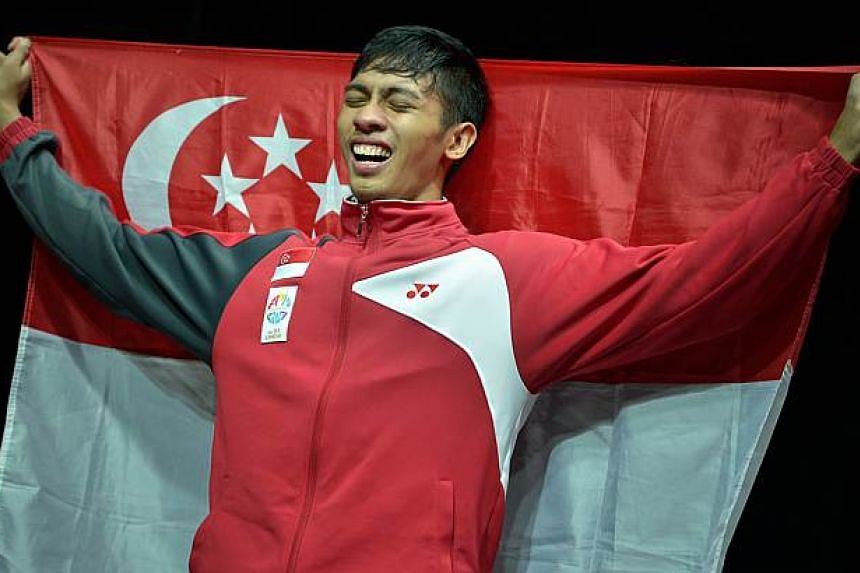 Alfian with the Singapore flag. -- ST PHOTO: KUA CHEE SIONG