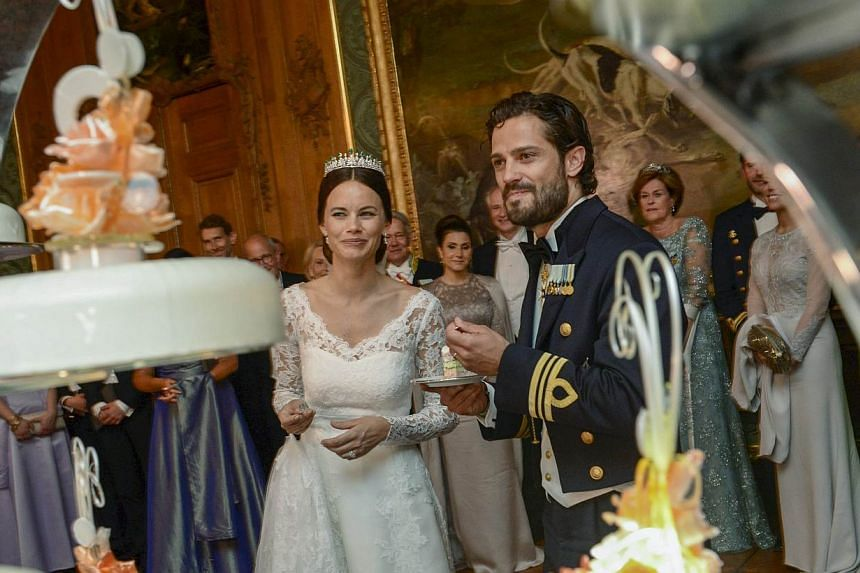 Swedish Princess Sofia and Prince Carl Philip cut the wedding cake during their wedding in the Royal Palace in Stockholm, Sweden, on June 13, 2015. -- PHOTO: REUTERS