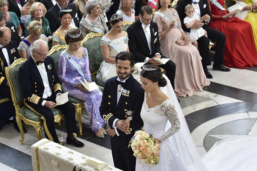 Swedish Prince Carl Philip and Princess Sofia during the wedding ceremony in the Royal Palace chapel in Stockholm, Sweden, on June 13, 2015. King Carl Gustaf of Sweden, Swedish Queen Silvia, Swedish Crown Princess Victoria, Price Daniel, Swedish Prin