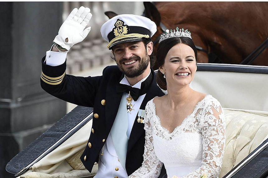 Swedish Prince Carl Philip and Princess Sofia wave to the crowd from an open carriage after being married in the Royal Palace chapel in Stockholm, Sweden, on June 13, 2015. -- PHOTO: EPA