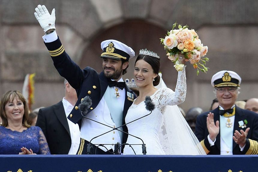 Sweden's Princess Sofia and Sweden's Prince Carl Philip greet the crowds after their wedding ceremony at Stockholm Palace on June 13, 2015. -- PHOTO: AFP