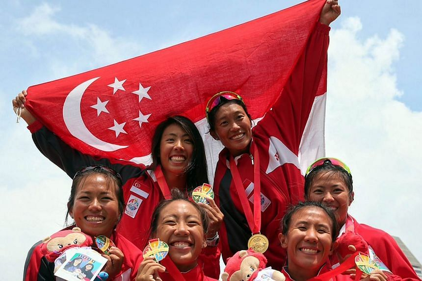 The women's canoe team posing with their medals after sweeping all three golds in the 500m races on June 8, 2015. Canoeing chipped in with a fantastic haul of seven golds. -- ST PHOTO: NEO XIAOBIN