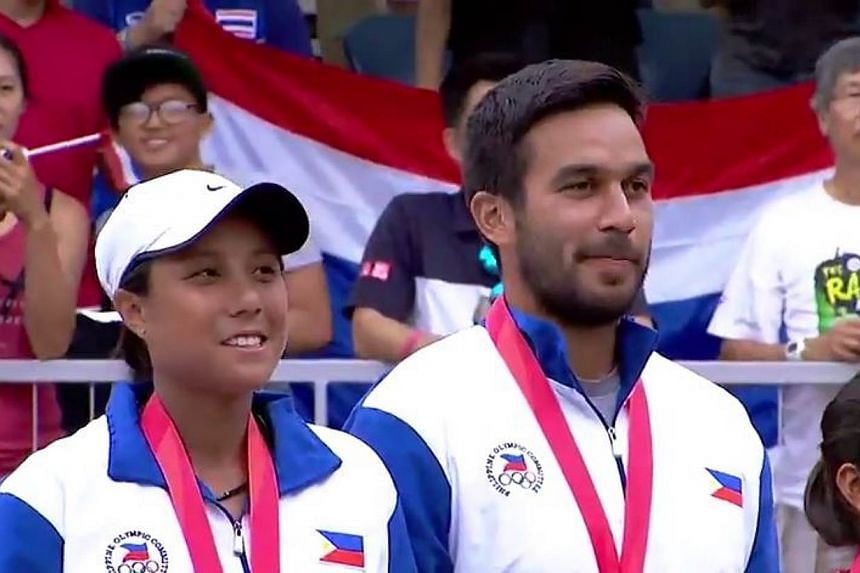 Denise Dy (left) and Treat Huey of the Philippines after receiving their gold medals for winning the tennis mixed doubles at the SEA Games. The victory by Dy and Huey prevented the Thais from getting a clean sweep of all the tennis golds at the games