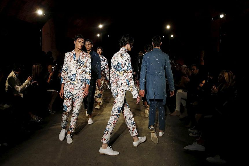 Models presenting creations from the Alexander McQueen Spring/Summer 2015 collection during London Collections: Men in London, Britain on June 14, 2015. -- PHOTO: REUTERS