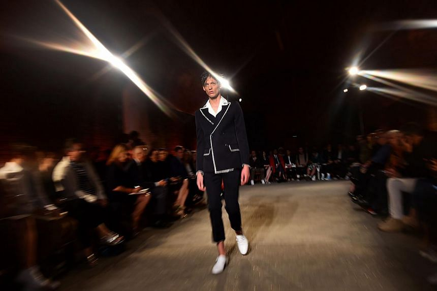 A model presenting a creation from the Alexander McQueen Spring/Summer 2015 collection during London Collections: Men in London, Britain, on June 14, 2015. -- PHOTO: AFP