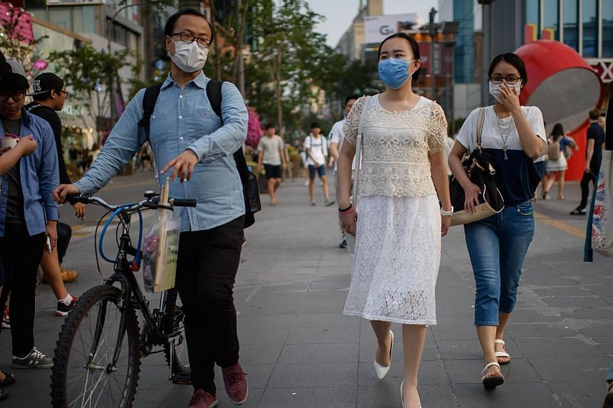 People wearing face masks in Seoul on June 14, 2015. -- PHOTO: AFP