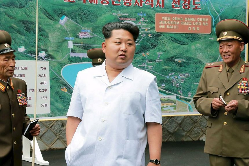 North Korean leader Kim Jong Un (centre) gives field guidance at a historic site associated with the Korean War in this undated photograph released by North Korea's Korean Central News Agency (KCNA) in Pyongyang on June 9, 2015. -- PHOTO: REUTERS