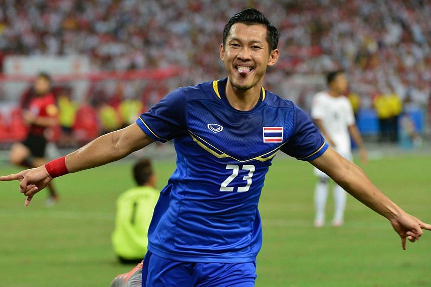 Thailand's Pombubpha Chananan celebrates scoring their second goal against Myanmar in their SEA games final at the National Stadium on June 15, 2015. Thailand extended their stranglehold over regional football, cruising to a 3-0 win over Myanmar