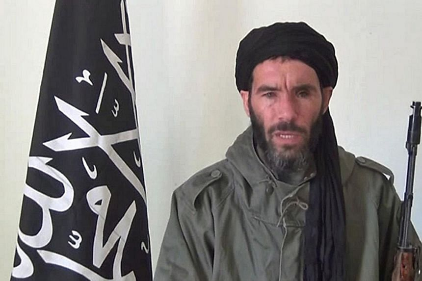 A file photograph taken on Jan 17, 2013, an undated grab from a video obtained by ANI Mauritanian news agency, reportedly shows former Al-Qaeda in the Islamic Maghreb (AQIM) emir Mokhtar Belmokhtar speaking at an undisclosed location. -- PHOTO: AFP&n