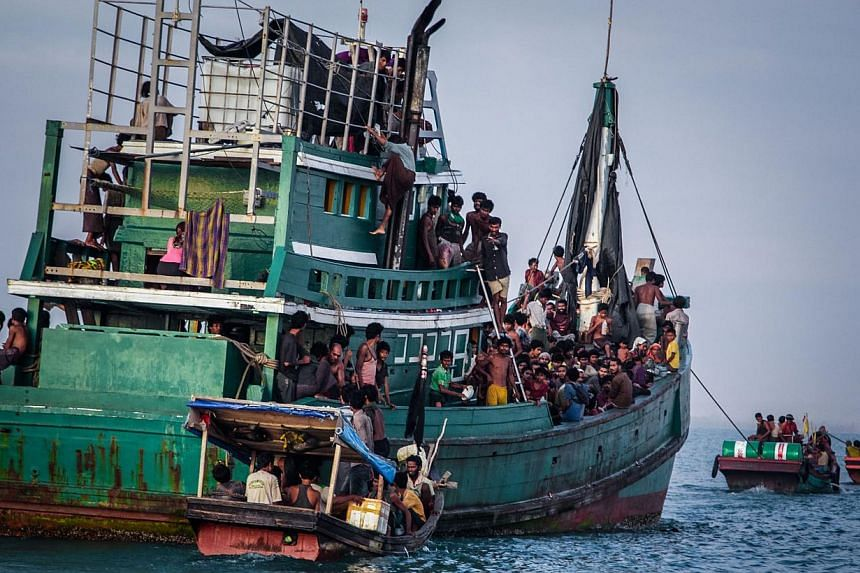 Rohingya migrants resting on a boat off the coast near Kuala Simpang Tiga in Indonesia's East Aceh district of Aceh province before being rescued. -- PHOTO: AFP