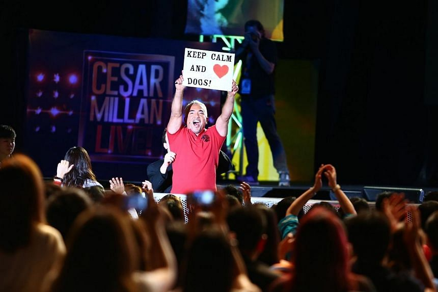 Dog trainer Cesar Millan with a sign made by a fan at his show. -- PHOTO: UNUSUAL ENTERTAINMENT