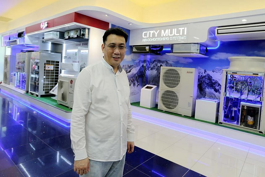 (Above) Gain City managing director Kenny Teo at the electronics megastore (below) in Sungei Kadut, which officially opened on June 5. The savings in rental and other business costs mean prices at the new store are up to 20 per cent lower than at its
