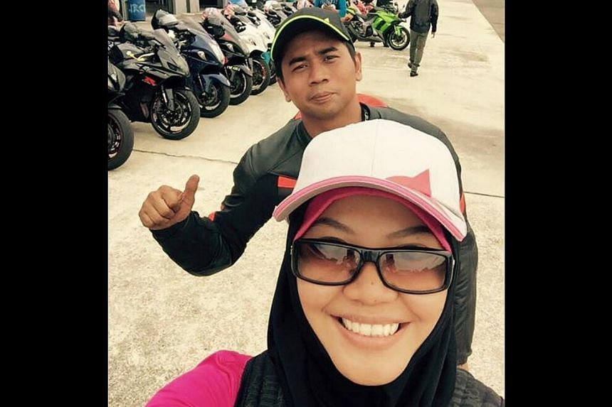 TOGETHER: A picture posted on May 27 showing Madam Maslin and Mr Jumarie at the Johor Circuit, a motorsport race track in Pasir Gudang, Malaysia. -- PHOTO: FACEBOOK/MASLIN AB