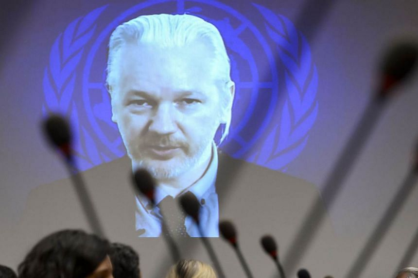 WikiLeaks founder Julian Assange is seen on a screen speaking via web cast from the Ecuadorian Embassy in London during an event on the sideline of the United Nations (UN) Human Rights Council session on March 23, 2015 in Geneva. Swedish prosecu