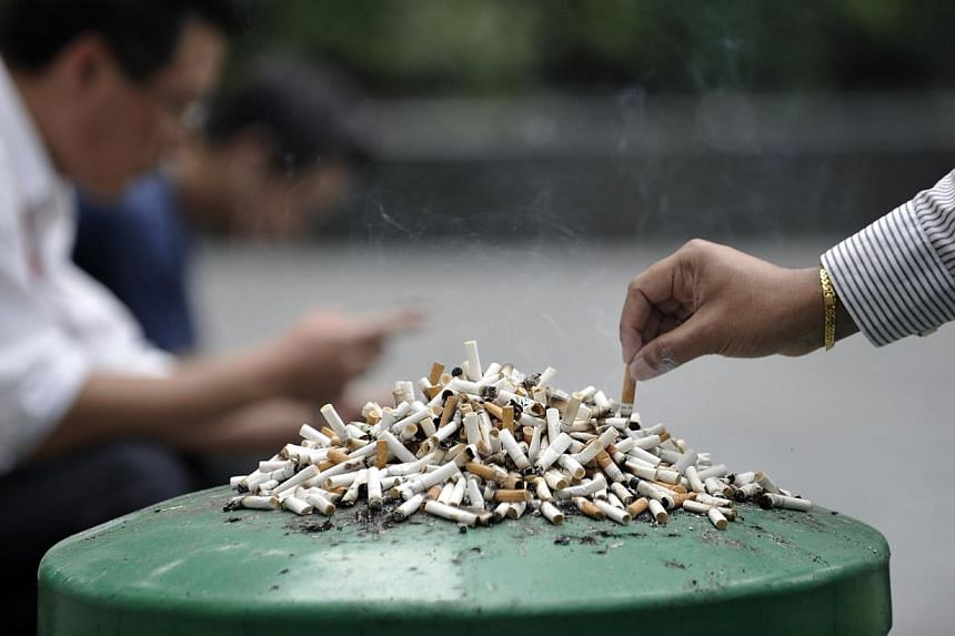 Stubbed-out cigarettes left on a dustbin. The Ministry of Health is moving to ban new forms of cigarettes including smokeless cigarettes and dissolvable tobacco or nicotine from Dec 15, 2015. -- PHOTO: ST FILE