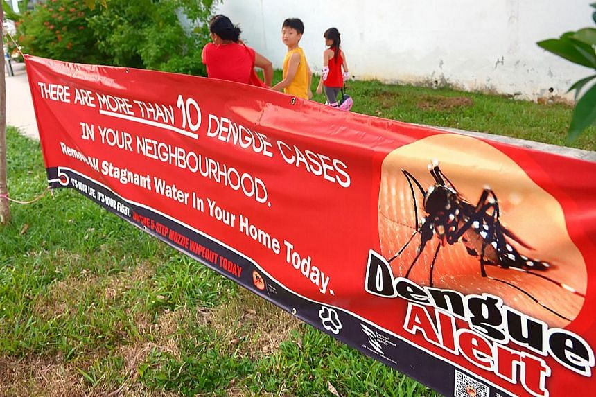 A dengue alert banner in Lorong L, Telok Kurau. The number of dengue cases so far this year has fallen by almost half compared to the same period last year but the National Environment Agency (NEA) has urged Singaporeans to remain vigilant against th