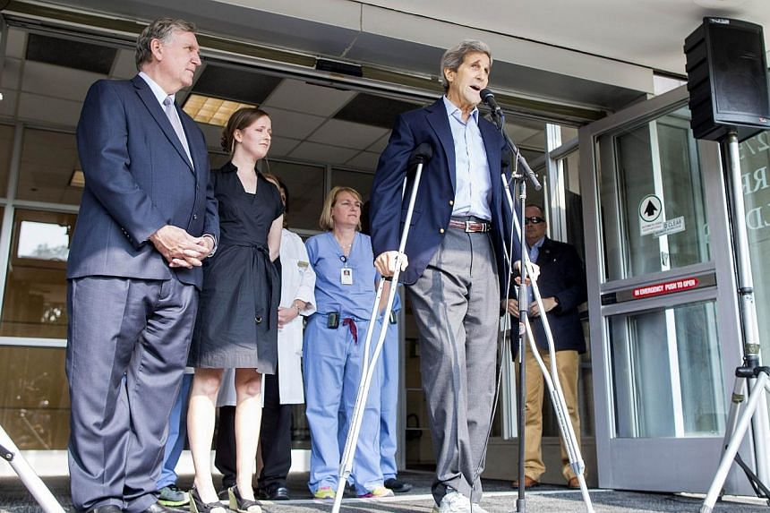 Secretary of State John Kerry speaks to the press on crutches after being discharged from Massachusetts General Hospital on June 12, 2015 in Boston, Massachusetts.Mr Kerry is taking nothing more than pain relief medicine Tylenol for his broken