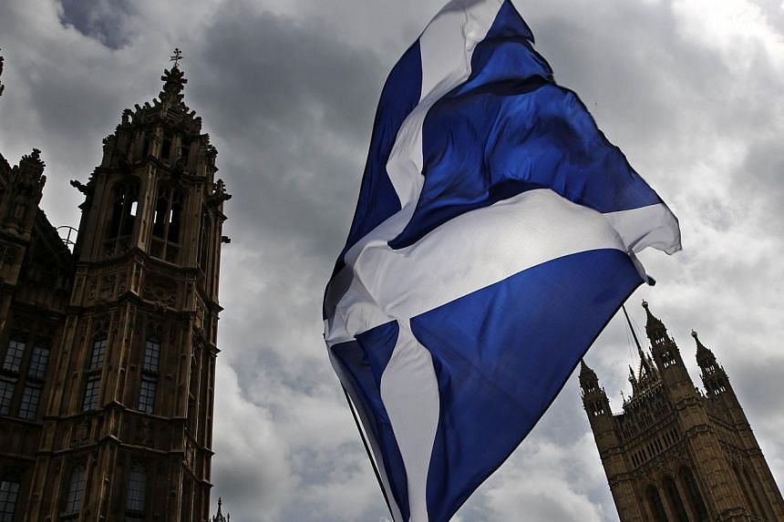 The Scottish National Party (SNP) has threatened to call for another referendum to break up the United Kingdom unless the British government agrees to devolve more powers to Scotland, the Financial Times reported on Monday, June 15, 2015. -- PHOTO: A