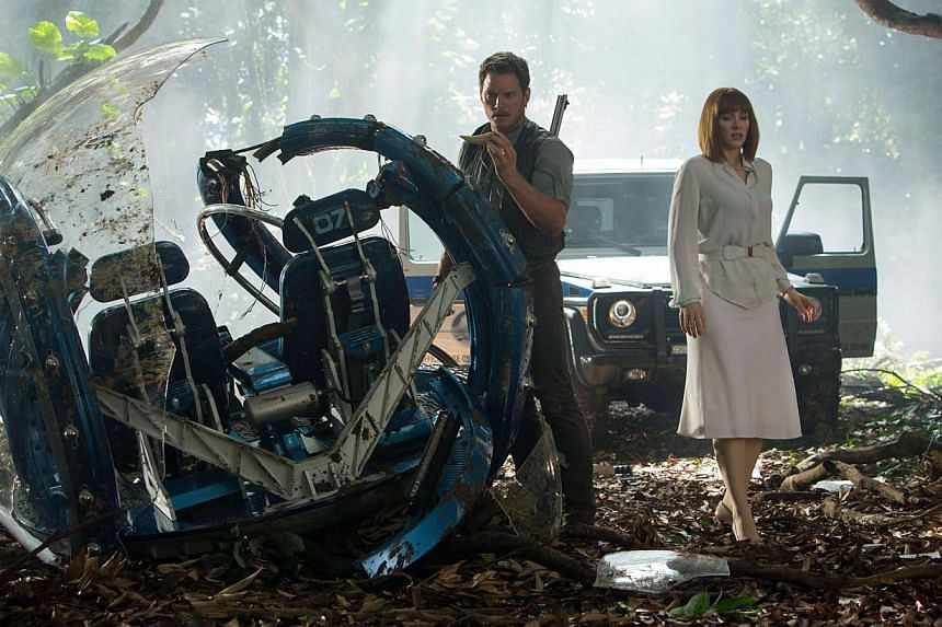 Still from the movie Jurassic World starring Chris Pratt (left) and Bryce Dallas Howard. The action-packed movie, featuring a new and particularly lethal hybrid dinosaur, debuted in global cinemas with a whopping US$511 million (S$688.7 million), sai