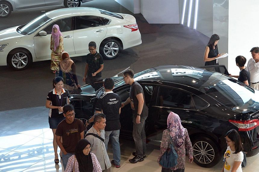 Cars sales buoyed retail sector in Singapore once again, showing a 5 per cent rise in April 2015 compared to the previous year, a release by the Department of Statistics reported on Monday. -- PHOTO: ST FILE