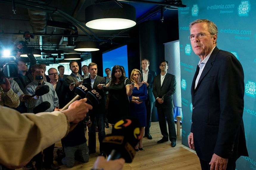 Jeb Bush, former Florida governor, speaks to the press at the e-Estonia Showroom during his visit to Tallinn, Estonia, on Saturday (June 13). -- PHOTO: BLOOMBERG
