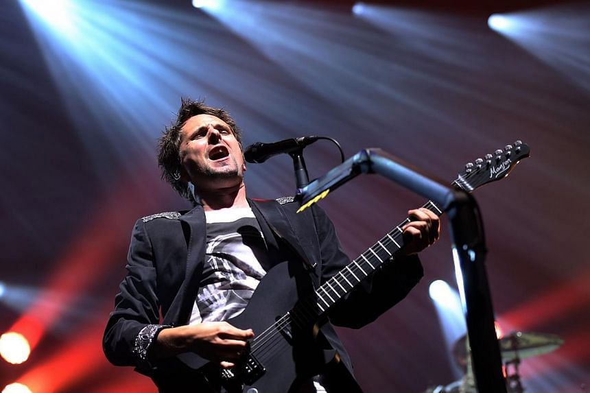 Matthew Bellamy of British rock band  Muse performs at the Olympia concert hall in Paris. -- PHOTO: AFP