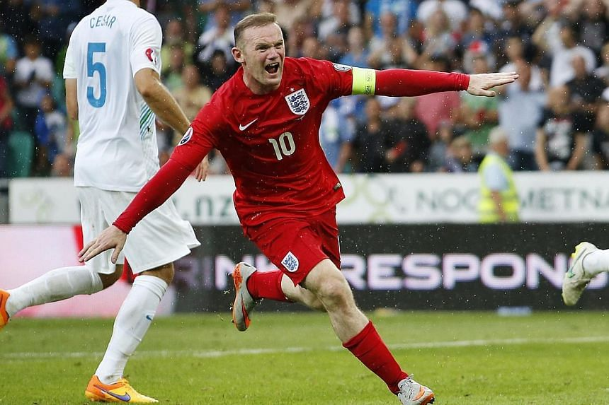 Wayne Rooney celebrates after scoring in the qualifier in Slovenia. -- PHOTO: REUTERS