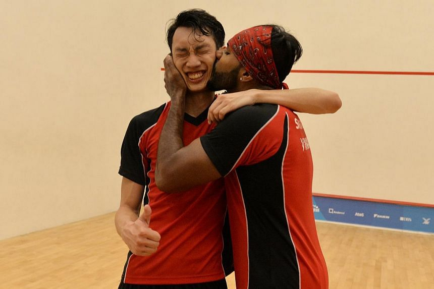 Singapore's Vivian Rhamanan (right) planting a kiss on the cheek of partner Marcus Phua after the duo beat Indonesia's Ade Furkon and Sandi A. Perdana 2-0 at the Tanglin Club on June 15, 2015, to win the men's jumbo doubles event. -- ST PHO