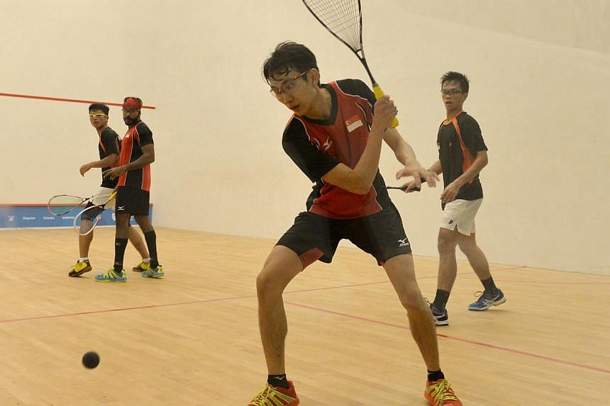 Marcus Phua competing in the men's jumbo doubles final. -- ST PHOTO: CAROLINE CHIA
