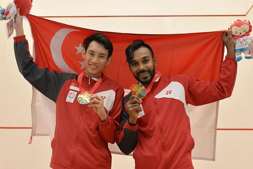 Marcus Phua and Vivian Rhamanan with their gold medals. -- ST PHOTO: CAROLINE CHIA